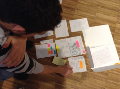 Participant evaluating the paper prototype