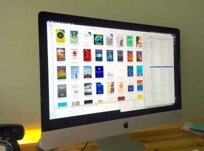 A computer showing a set of ebooks